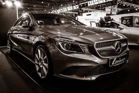 STUTTGART, GERMANY - MARCH 02, 2017: Compact car Mercedes-Benz CLA200 (C117), 2016. Toning. Europes greatest classic car exhibition RETRO CLASSICS Editorial