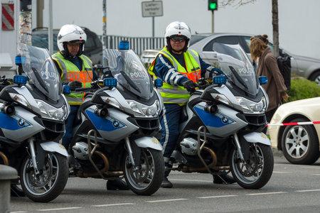 ensuring: BERLIN - APRIL 02, 2017: The annual 37th Berlin Half Marathon. Ensuring public order. The police are at work.