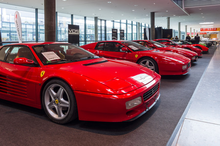 STUTTGART, GERMANY - MARCH 03, 2017: The various modifications of sports cars Ferrari Testarossa and F512 TR. Europes greatest classic car exhibition RETRO CLASSICS