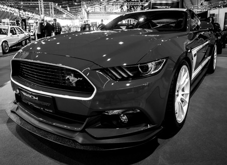 classics: STUTTGART, GERMANY - MARCH 03, 2017: Pony car Ford Mustang GT AM2 Fastback Coupe, 2016. Black and white.Europes greatest classic car exhibition RETRO CLASSICS