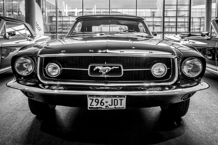 STUTTGART, GERMANY - MARCH 03, 2017: Pony car Ford Mustang convertible, 1967. Black and white. Europes greatest classic car exhibition RETRO CLASSICS
