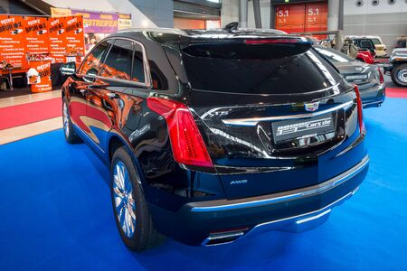 STUTTGART, GERMANY - MARCH 03, 2017: Mid-size luxury crossover SUV Cadillac XT5 Platinum, 2017. Rear view. Europes greatest classic car exhibition RETRO CLASSICS Editorial