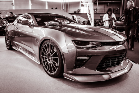 STUTTGART, GERMANY - MARCH 03, 2017: Muscle car The Chevrolet Camaro SS (sixth generation), 2016. Stylization. Toning. Europes greatest classic car exhibition RETRO CLASSICS