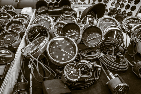 STUTTGART, GERMANY - MARCH 03, 2017: The point of sale of speedometers, tachometers and odometers for vintage cars. Sepia toning. Europes greatest classic car exhibition RETRO CLASSICS