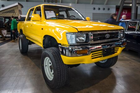 STUTTGART, GERMANY - MARCH 03, 2017: Compact pickup truck Toyota Hilux, 1992. Europes greatest classic car exhibition RETRO CLASSICS