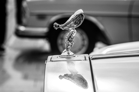 STUTTGART, GERMANY - MARCH 04, 2017: The famous emblem Spirit of Ecstasy on the Rolls-Royce Silver Spirit. Black and white. Europes greatest classic car exhibition RETRO CLASSICS