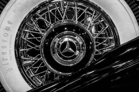 STUTTGART, GERMANY - MARCH 04, 2017: Spare wheel of Mercedes-Benz 770K (W150), 1931. Black and white. Europes greatest classic car exhibition RETRO CLASSICS Editorial