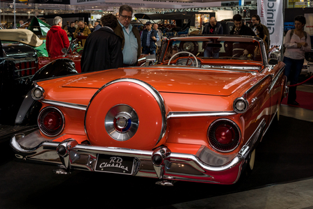 retractable: STUTTGART, GERMANY - MARCH 04, 2017: Full-size car Ford Galaxie Skyliner Retractable Hardtop, 1959. Rear view. Europes greatest classic car exhibition RETRO CLASSICS
