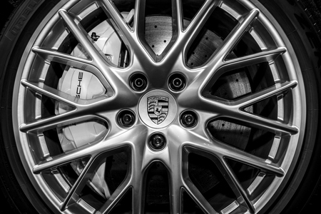 STUTTGART, GERMANY - MARCH 04, 2017: The braking system of the full-size luxury car Porsche Panamera Turbo, 2016. Black and white. Europes greatest classic car exhibition RETRO CLASSICS