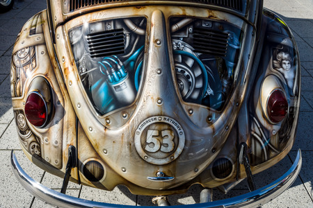 STUTTGART, GERMANY - MARCH 04, 2017: Fragment of compact car Volkswagen Beetle in unusual body painting (aerography). Europes greatest classic car exhibition RETRO CLASSICS Editorial