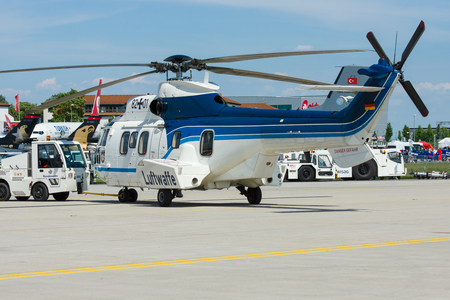 BERLIN, GERMANY - MAY 21, 2014: Medium Utility Helicopter Eurocopter AS532 Cougar. German Air Force. Exhibition ILA Berlin Air Show 2014