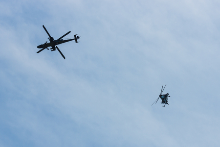 BERLIN, GERMANY - MAY 21, 2014: Demonstration flight of attack helicopter Eurocopter Tiger UHT. Exhibition ILA Berlin Air Show 2014 Editorial