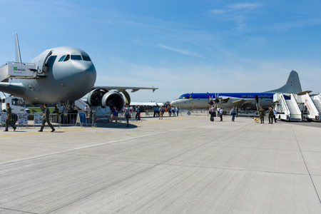 lockheed martin: BERLIN, GERMANY - MAY 21, 2014: Lockheed Martin P3C Orion and Airbus A310 Multi Role Tanker Transport (MRTT) on the airfield. German Air Force. Exhibition ILA Berlin Air Show 2014 Editorial