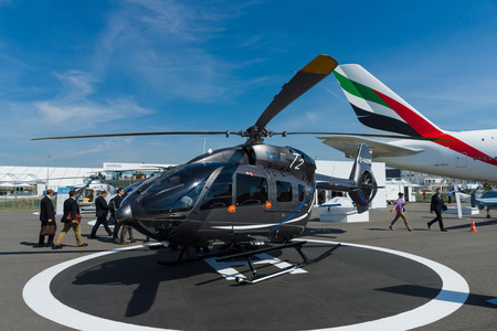 BERLIN, GERMANY - MAY 21, 2014: A twin-engine light utility helicopter - Eurocopter EC145 T2. Exhibition ILA Berlin Air Show 2014 Editorial