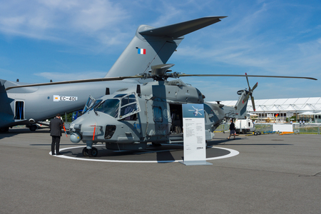 BERLIN, GERMANY - MAY 21, 2014: A medium sized, twin-engine, multi-role military helicopter - NH90 NFH (NATO Frigate Helicopter). German Army. Exhibition ILA Berlin Air Show 2014