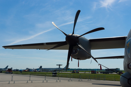BERLIN, GERMANY - MAY 21, 2014: Turboprop engine Rolls-Royce AE2100-D2A closeup a medium-sized military transport aircraft Alenia C-27J Spartan. Romanian Air Force. Exhibition ILA Berlin Air Show 2014