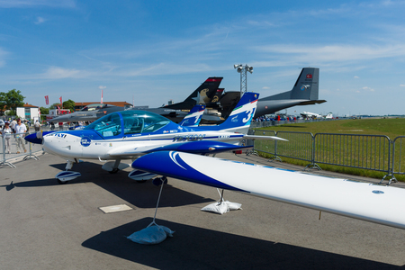 BERLIN, GERMANY - MAY 21, 2014: Italian ultralight aircraft and Light-sport aircraft, Fly Synthesis Texan Top Class 600. Wefly Team. Exhibition ILA Berlin Air Show 2014
