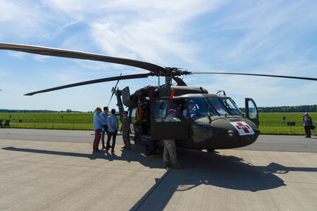 BERLIN, GERMANY - MAY 21, 2014: A four-bladed, twin-engine, medium-lift utility helicopter HH-60M Black Hawk (MEDEVAC). US Air Force. Exhibition ILA Berlin Air Show 2014