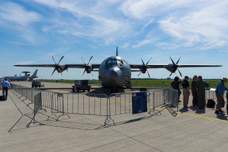 lockheed martin: BERLIN, GERMANY - MAY 21, 2014: A four-engine turboprop military transport aircraft Lockheed Martin C-130J Super Hercules. US Air Force. Exhibition ILA Berlin Air Show 2014