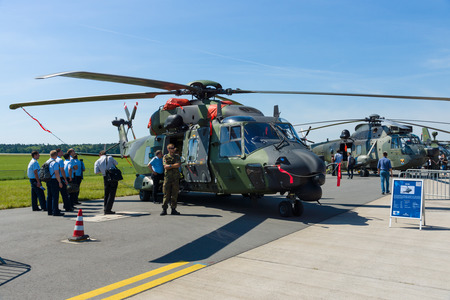 BERLIN, GERMANY - MAY 21, 2014: A medium sized, twin-engine, multi-role military helicopter NHIndustries NH90. German Army. Exhibition ILA Berlin Air Show 2014 Editöryel
