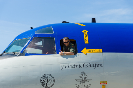 BERLIN, GERMANY - MAY 21, 2014: The pilot of the four-engine turboprop anti-submarine and maritime surveillance aircraft Lockheed P-3C Orion. German Navy. Exhibition ILA Berlin Air Show 2014 Editorial