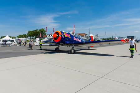 BERLIN, GERMANY - MAY 21, 2014: A single-engined advanced trainer aircraft North American T-6 Texan. Flying Bulls Team. Exhibition ILA Berlin Air Show 2014