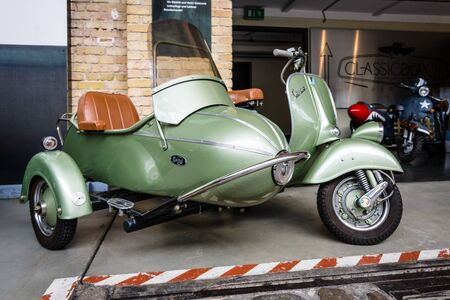BERLIN - MAY 13, 2017: Scooter Vespa with Cozy Sidecar. Exhibition Oldtimertage Berlin-Brandenburg.