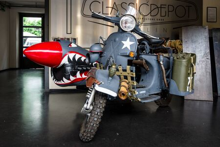 sidecar: BERLIN - MAY 13, 2017: Scooter Vespa with sidecar in military color. Exhibition Oldtimertage Berlin-Brandenburg.