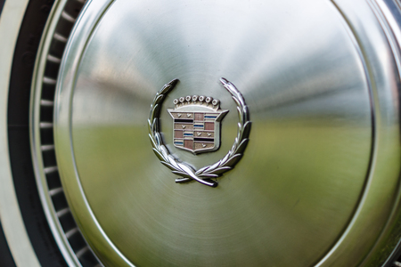 PAAREN IM GLIEN, GERMANY - JUNE 03, 2017: Hubcap of a full-size personal luxury car Cadillac Eldorado. Exhibition Die Oldtimer Show.
