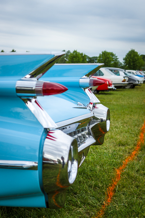 PAAREN IM GLIEN, GERMANY - JUNE 03, 2017: Rear stoplights of a full-size luxury car Cadillac Coupe DeVille, 1959 (focus in the background) Exhibition Die Oldtimer Show.