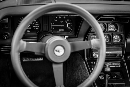 auto focus: PAAREN IM GLIEN, GERMANY - JUNE 03, 2017: Interior of the sports car Chevrolet Corvette (C3), 1982. Black and white. Focus on the background. Exhibition Die Oldtimer Show. Editorial