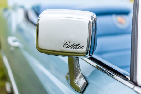 PAAREN IM GLIEN, GERMANY - JUNE 03, 2017: Rear view mirror of a full-size personal luxury car Cadillac Eldorado (Seventh generation). Exhibition Die Oldtimer Show. Editorial