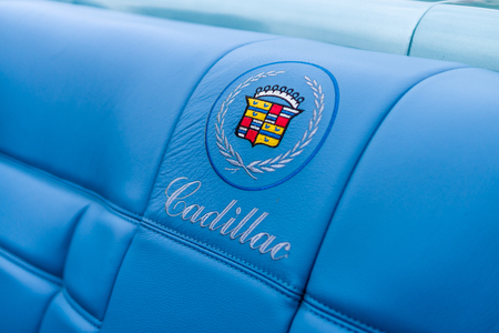 PAAREN IM GLIEN, GERMANY - JUNE 03, 2017: Emblem in the form of embroidery on the seat-cover of a full-size personal luxury car Cadillac Eldorado. Exhibition Die Oldtimer Show. Editorial