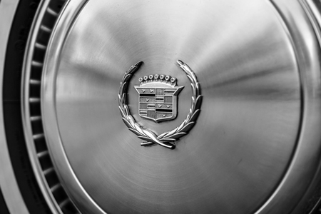 personal ornaments: PAAREN IM GLIEN, GERMANY - JUNE 03, 2017: Hubcap of a full-size personal luxury car Cadillac Eldorado. Black and white. Exhibition Die Oldtimer Show. Editorial