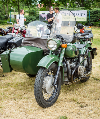 PAAREN IM GLIEN, GERMANY - JUNE 03, 2017: Soviet heavy motorcycle with a sidecar IMZ-Ural. Exhibition Die Oldtimer Show.