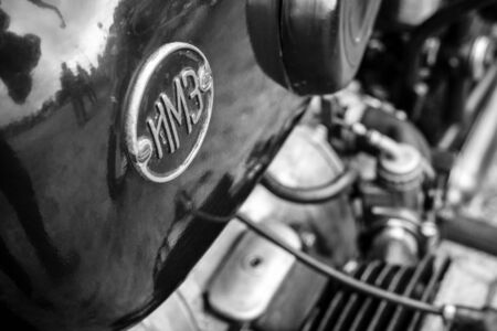 sidecar: PAAREN IM GLIEN, GERMANY - JUNE 03, 2017: Emblem of a Soviet heavy motorcycle with a stroller IMZ-Ural. Black and white. Exhibition Die Oldtimer Show.