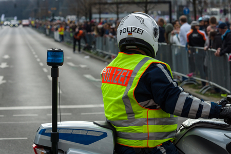 BERLIN - APRIL 02, 2017: The annual 37th Berlin Half Marathon. Ensuring public order. The police are at work.