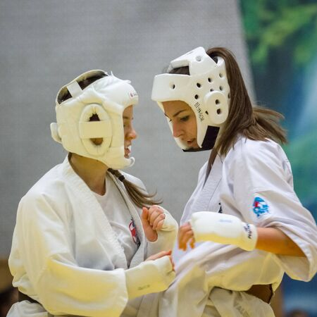 BERLIN - MARCH 18, 2017: Girls-fighters on the tatami. European championship Kyokushin World Union (KWU) for Children and Youth.