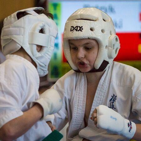 BERLIN - MARCH 18, 2017: Fighters on the tatami, close-up. European championship Kyokushin World Union (KWU) for Children and Youth.