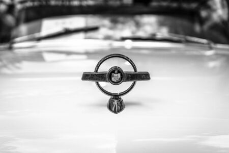 turnpike: BERLIN - JUNE 17, 2017: Hood ormanent of full-size car Ford Mercury Turnpike Cruiser, 1957. Black and white. Classic Days Berlin 2017.