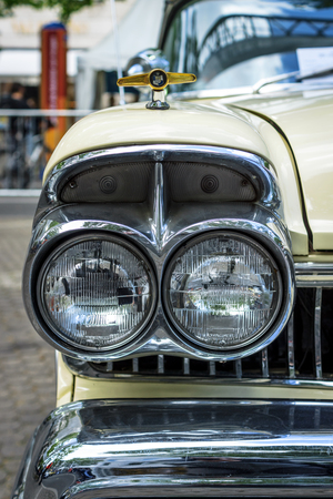 schlagbaum: BERLIN - JUNE 17, 2017: Headlamp of the full-size car Ford Mercury Turnpike Cruiser, 1957. Classic Days Berlin 2017.
