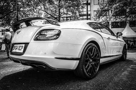 BERLIN - JUNE 17, 2017: Personal luxury car Bentley Continental GT, 2017. Rear view. Black and white. Classic Days Berlin 2017.