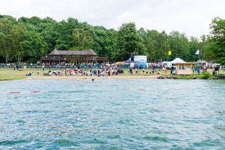 LAKE WERBELLINSEE, GERMANY - JUNE 25, 2017: Public beach. View from the side of the lake. Werbellinsee is a lake in the Barnim district of Brandenburg. During the GDR, the largest Young Pioneer camp was located.