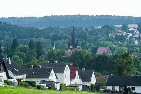 View of the small town of Neustadt (Marburg-Biedenkopf district in Hessen), a suburb and surrounding agricultural land.