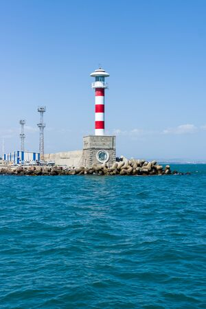 Lighthouse at the entrance to the water area of the sea port of Burgas. Bulgaria. Stok Fotoğraf