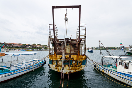 NESEBAR, BULGARIA - AUGUST 21, 2017: An old, rusty and abandoned ship Nymph in the seaport of Nesebar. Nesebar is an ancient city and one of the major seaside resorts on the Bulgarian Black Sea Coast.