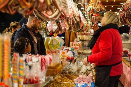 BERLIN - NOVEMBER 12, 2017: Tradition Christmas Market (Weihnachtsmarkt) on Potsdamer Platz. Sale of various gingerbreads, candies and sweets.