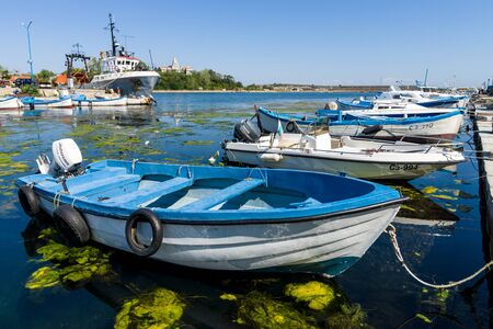 SOZOPOL, BULGARIA - AUGUST 24, 2017: Fishing boats at the seaport are at the pier. Editorial