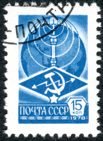 USSR - CIRCA 1978: A stamp printed in USSR, shows a Ostankino TV Tower, Globe and telecommunications emblem, circa 1978