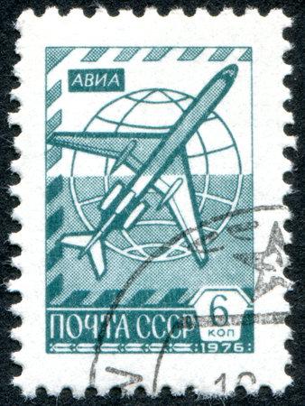 USSR - CIRCA 1976: A stamp printed in the USSR, shows the Globe and jetliner Tu-154, circa 1976 Redakční